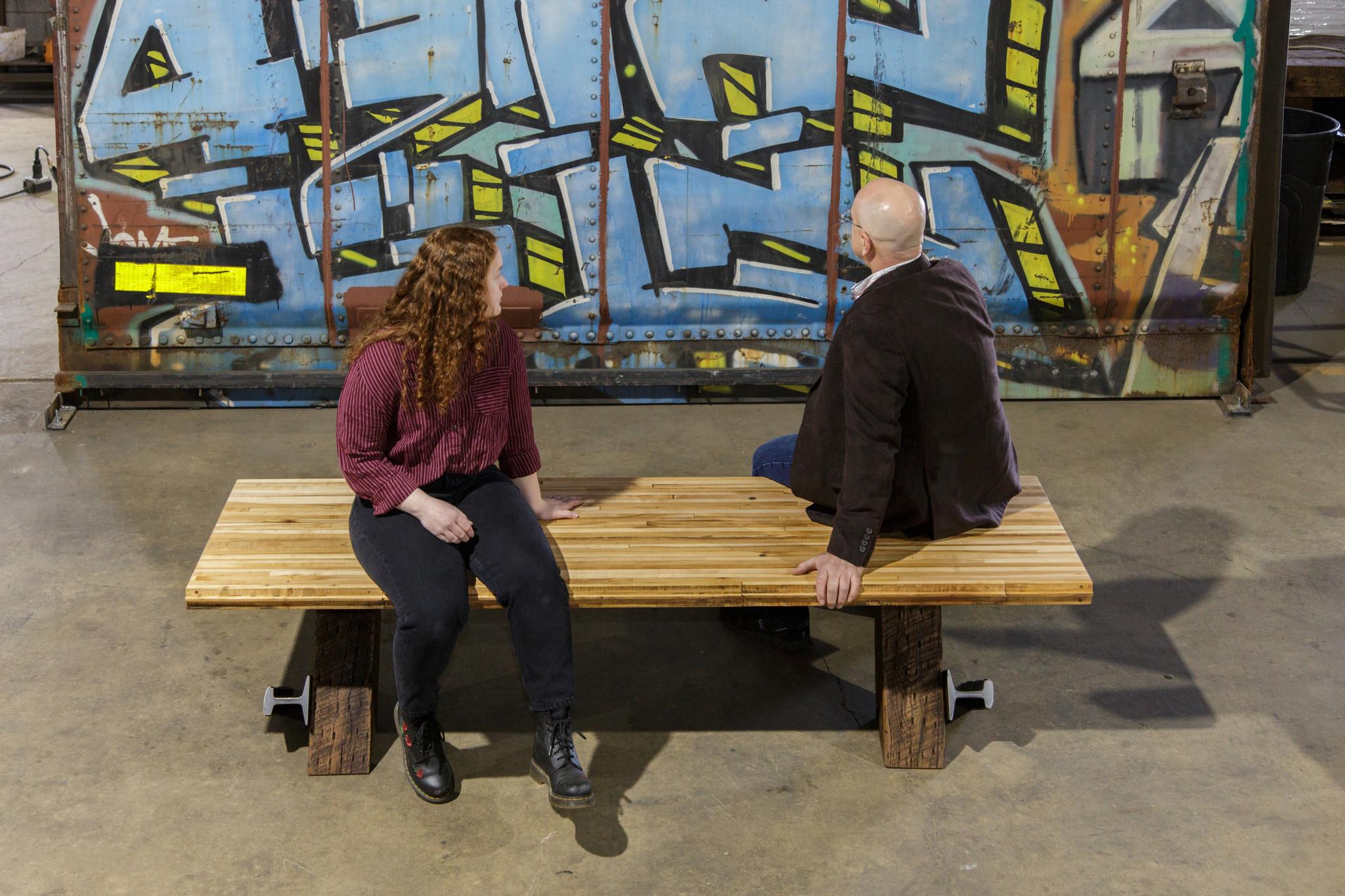 Museum space rectangular bench against graffiti background