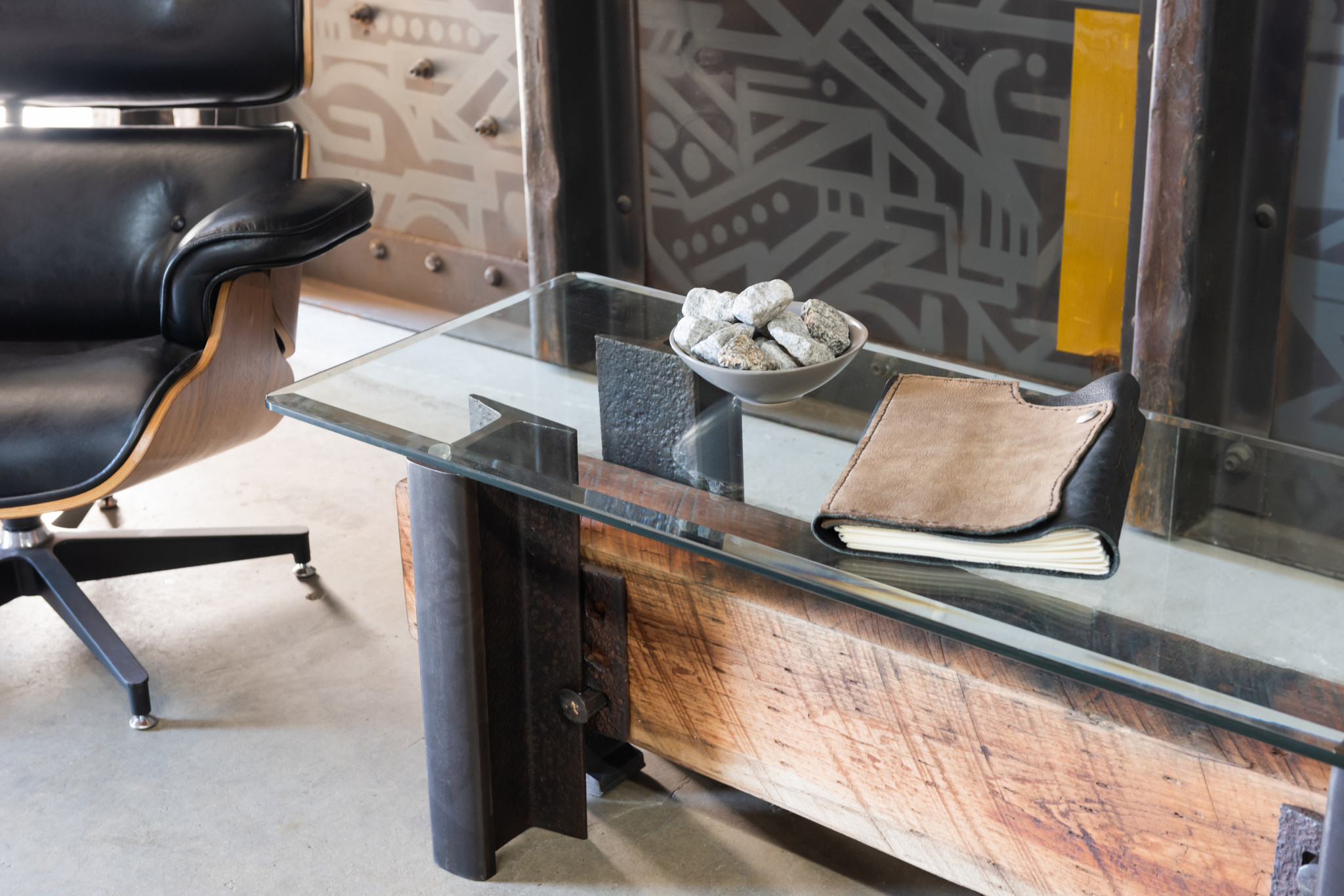 Eames chair next to low rustic coffee table