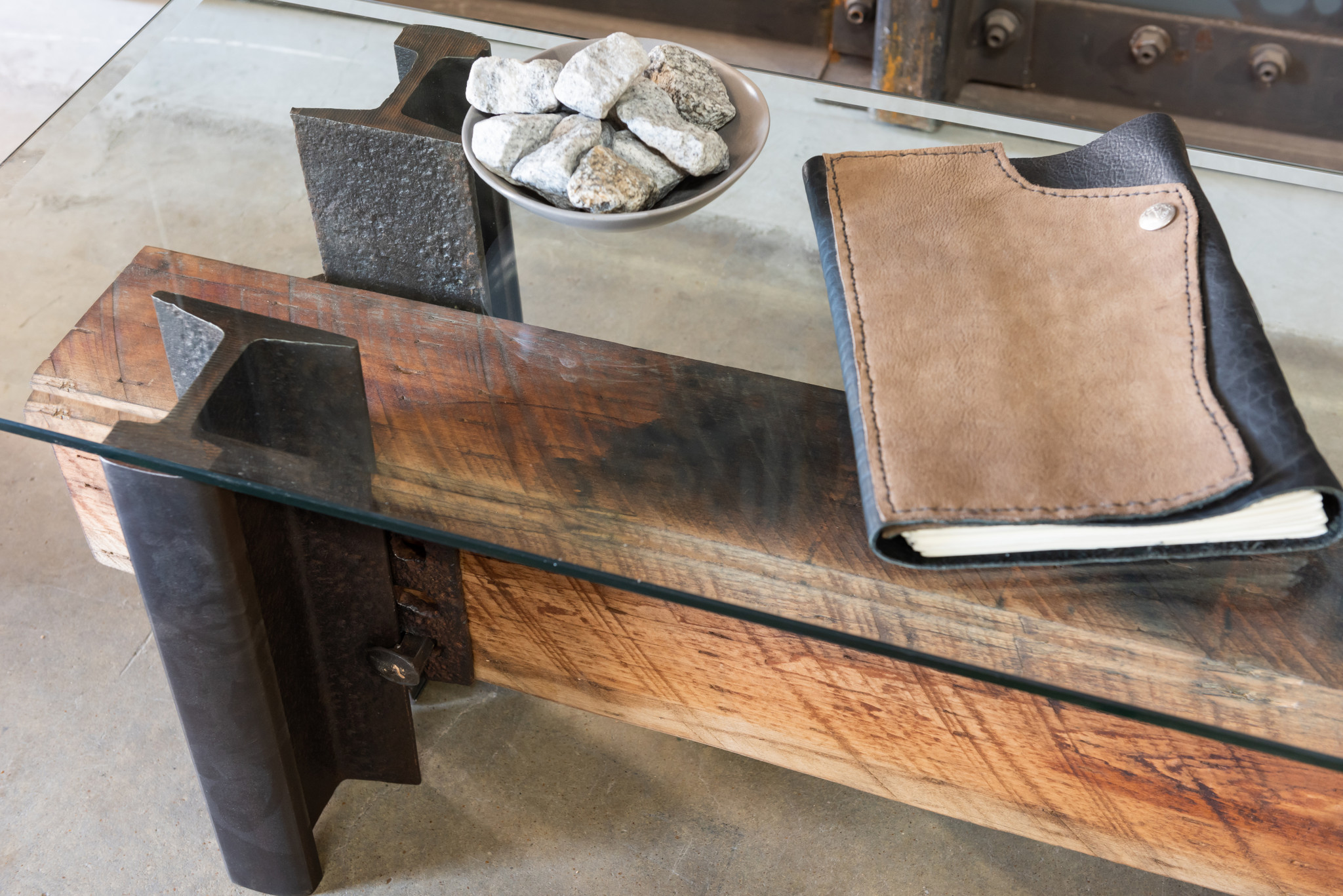 buffalo hide journal atop wood and steel coffee table