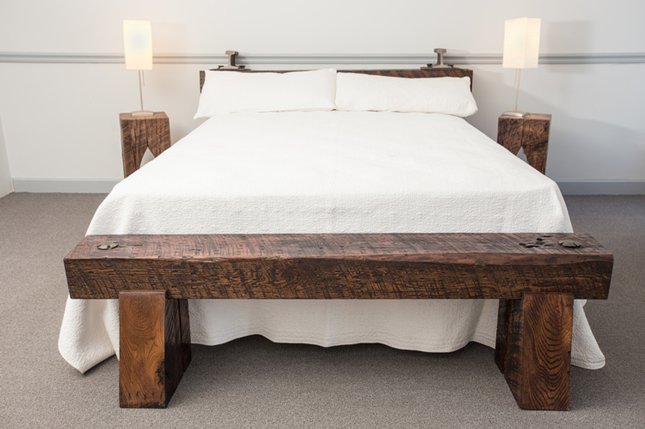 clean modern interior design style bed from oversized wood beams