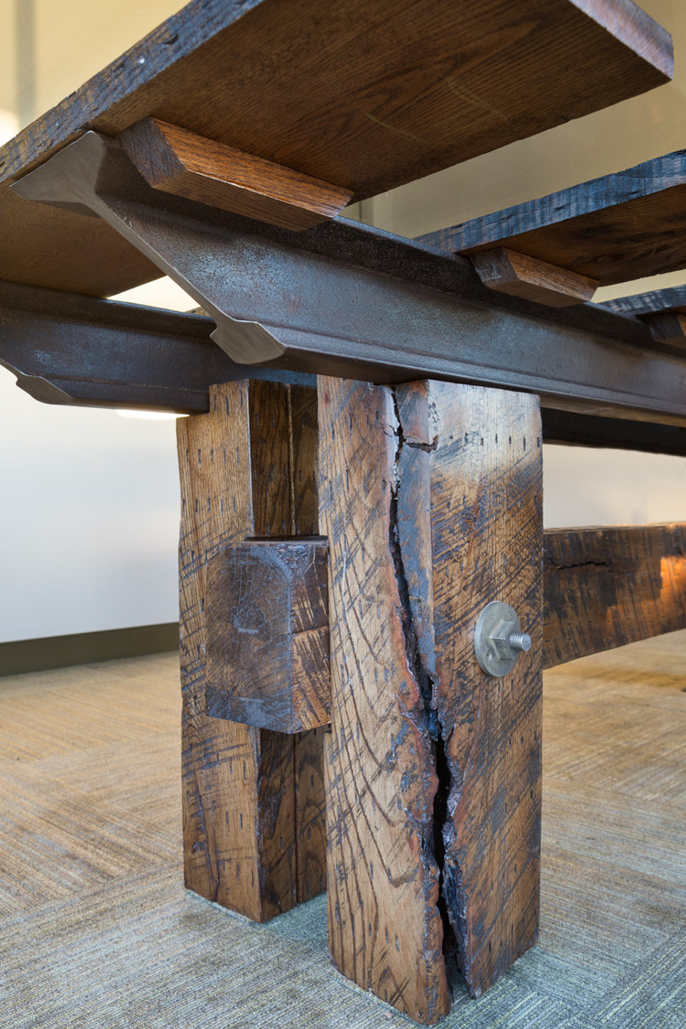 expensive distressed timber conference table