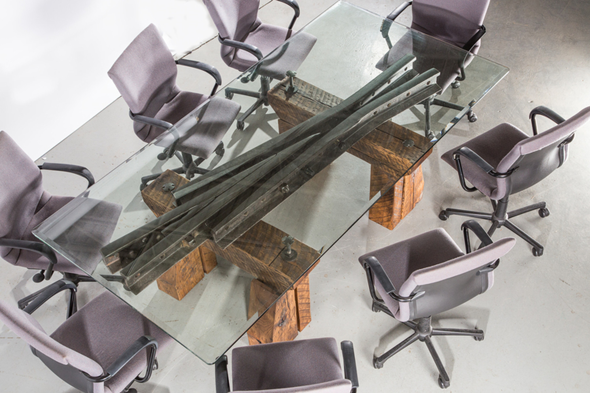 modern abstract steel under glass conference table from repurposed classic steel