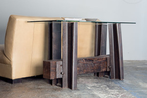 Sculptural furniture from reclaimed repurposed hardwood timber and bent steel railroad artifacts