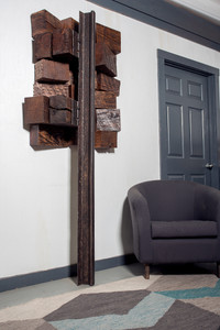 tall narrow abstract wall mounted sculptural art from reclaimed wood and railroad steel museum quality for residential, business or hotel