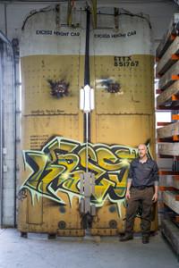 Big original graffiti spray paint on authentic steel railcar doors