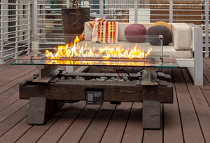 Sound-reactive fire pit with Harman-Kardon speakers and Bluetooth connectivity in a railroad-themed enclosure that is pure Industrial Age Americana with a history to go along with it.