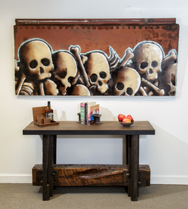 Ichabod skull montage over railroad table credenza