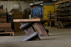 Oversized bench for public exhibit spaces from authentic industrial reclaimed materials
