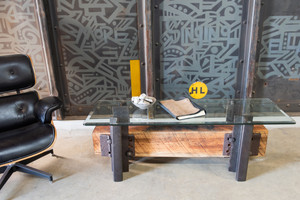 Graffiti backed coffee table with mid-century modern eames recliner