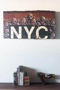 NYC red Ichabod oil bar panel on salvaged steel rail car