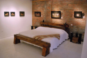 reclaimed timber footboard headboard bed. artisan made with salvaged iron accents for urban loft decor