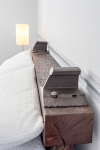 americana style railroad-themed oak timber headboard with steel rails