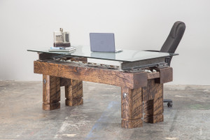 expensive executive ceo desk with reclaimed oversized historical industrial artifacts