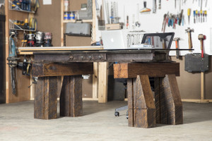 oversized executive desk from salvaged wood and repurposed steel with glass top