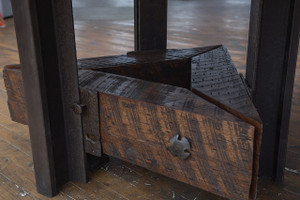 artisan hand crafted iron and steel base table