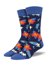 "These Hawaiian flower socks want to say ""Aloha!"" to you feet. With bold, beautiful colors, you're bound to start feeling that island breeze when you walk around in these floral socks. Be the big kahuna of your sock game!"