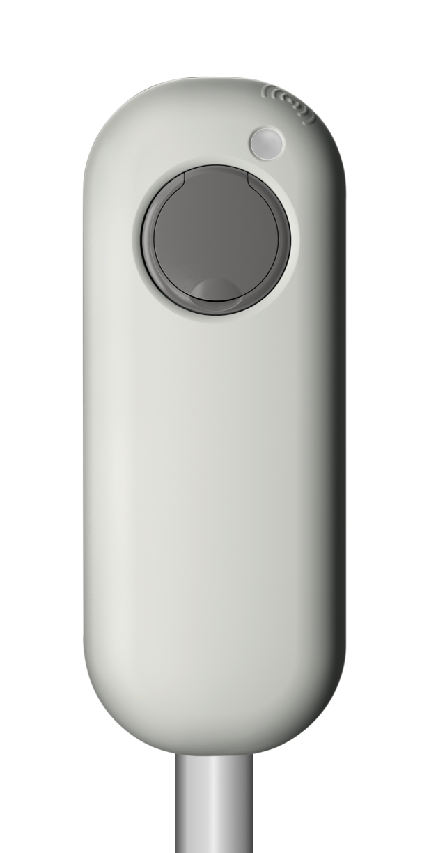 A white NewMotion home charge point on a pole.