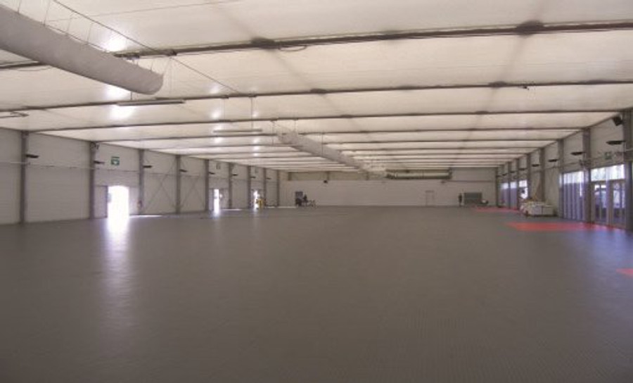 Perfection Floor Tile Commercial Smooth in a warehouse