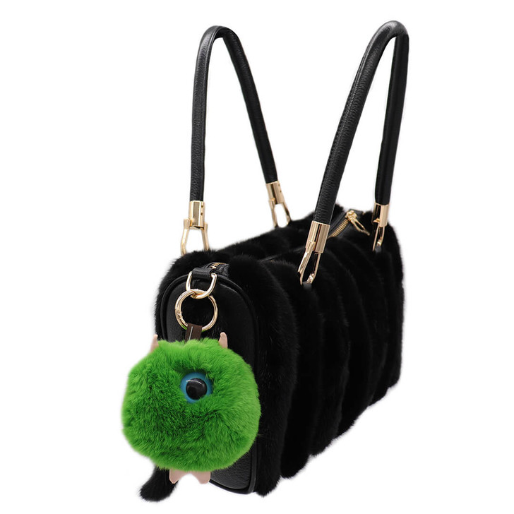 one-eyed green alien rex rabbit keychain on bag