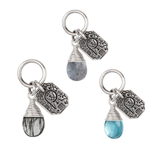 Attraction Charm with tag