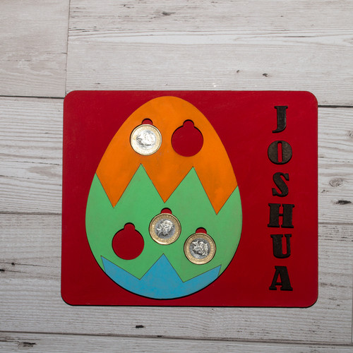 Personalised Easter egg coin holder with coins.