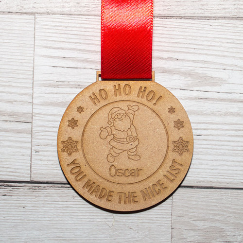 Personalised Christmas Nice List Medal with red ribbon