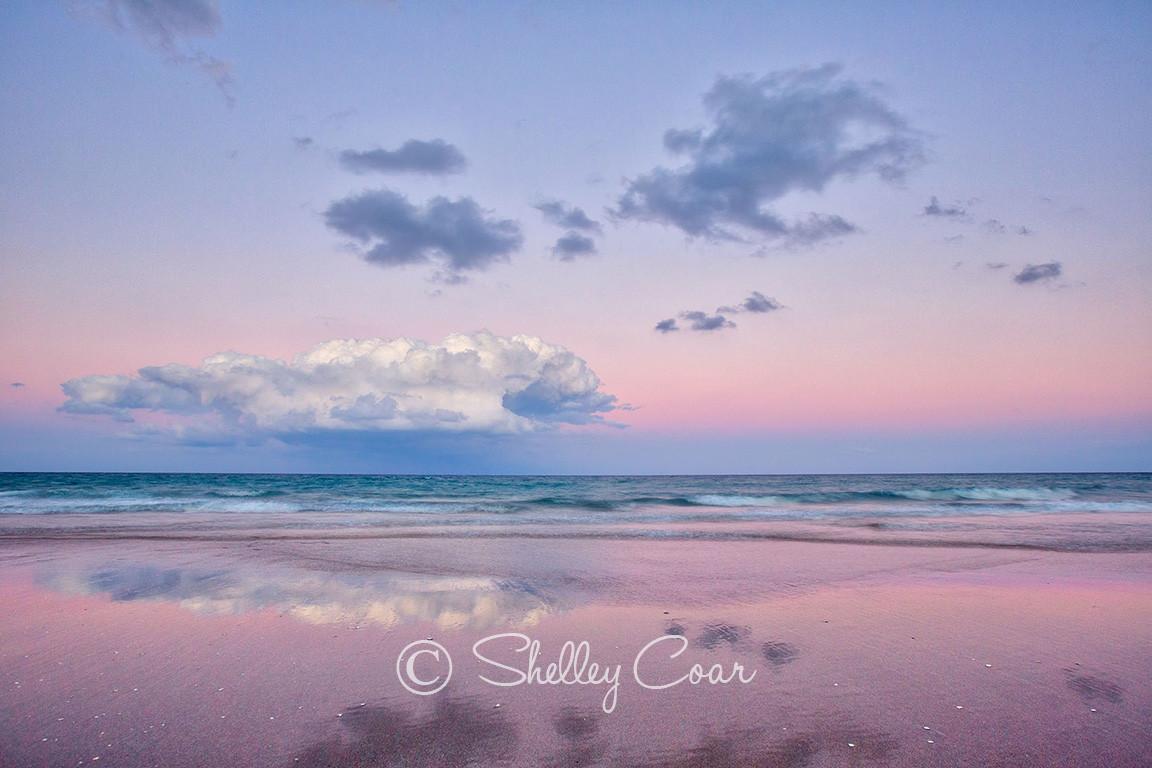 A beach sunset overlooking the Atlantic Ocean at Boca Raton, Florida. Landscape photograph by Shelley Coar.