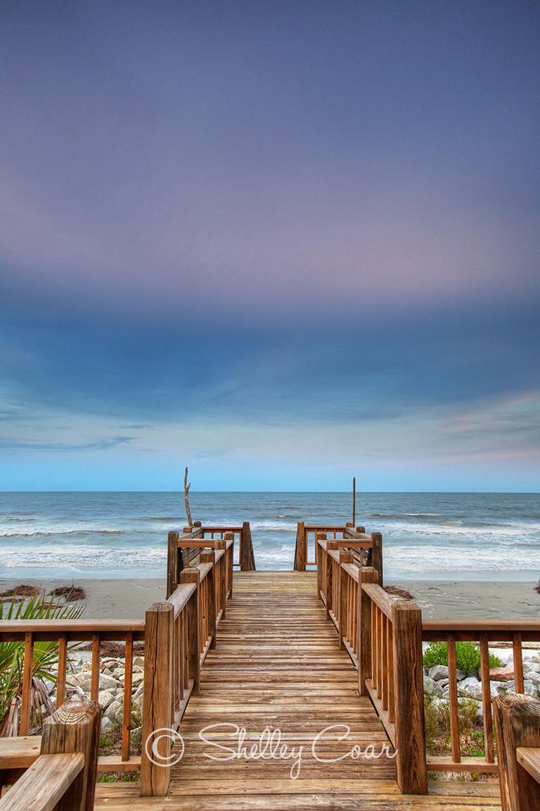 A photograph by Shelley Coar of beach sunset overlooking the Atlantic Ocean at Fripp Island, South Carolina.