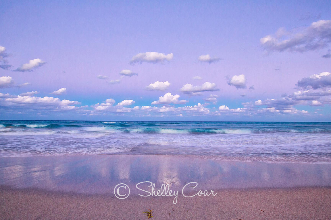 A purple sunset at the beach of Boca Raton, Florida looking out to the Atlantic Ocean. Landscape photograph by Shelley Coar.