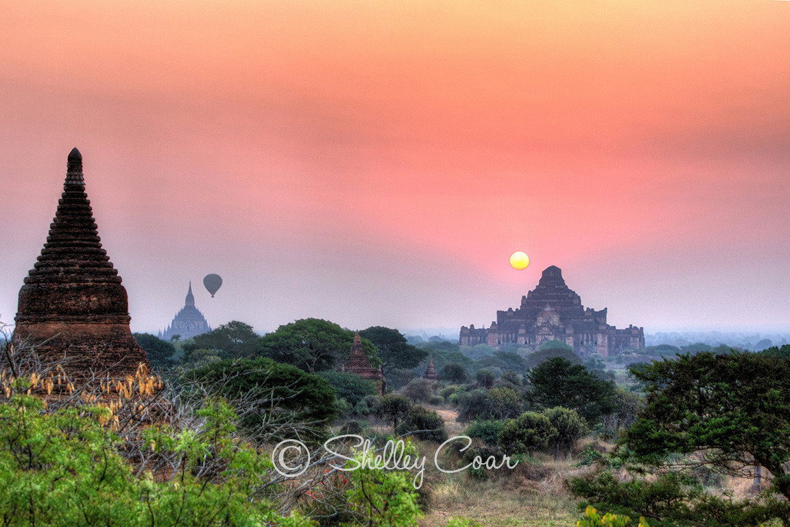 A photograph of a stunning sunrise over the pagodas of Bagan, Mayamar by Shelley Coar.