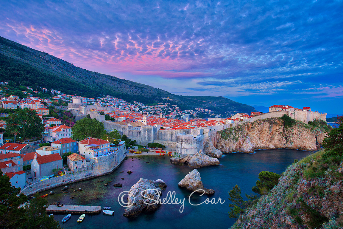 Photograph of a Old Town and Dubrovnik fortress walls overlooking the Adriatic sea by Shelley Coar.
