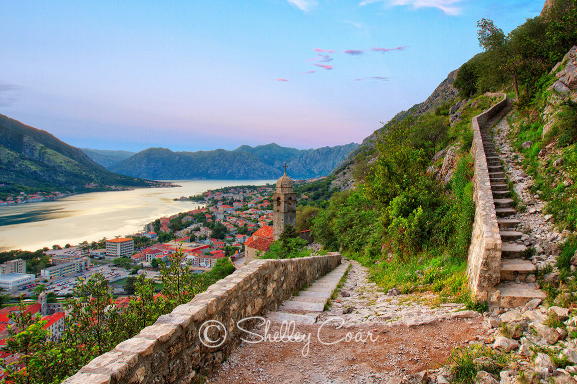 Photograph of a Old Town and Kotor, Montenegro fortress walls overlooking the Bay of Kotor by Shelley Coar.