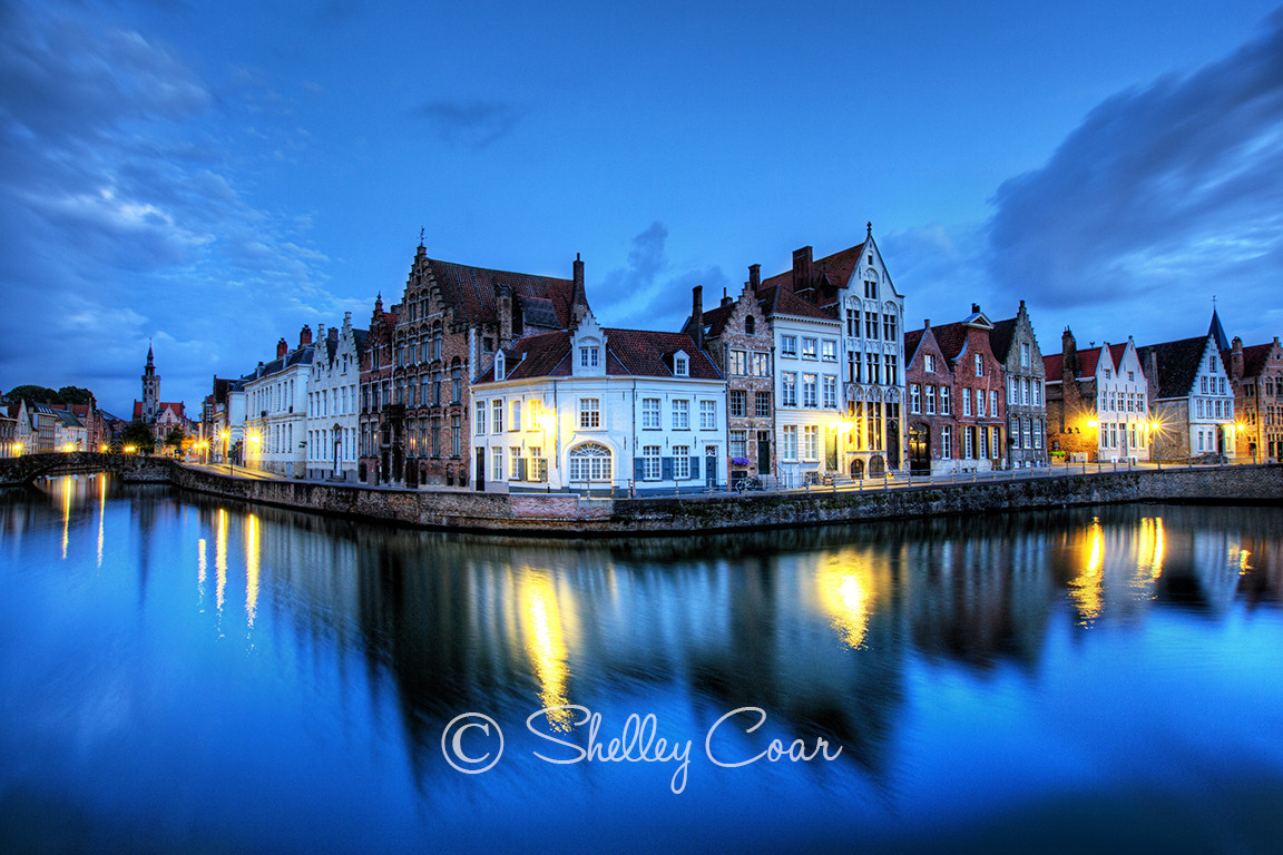 Whimsical photograph of the iconic canals in Bruges, Belgium at twilight by Shelley Coar.