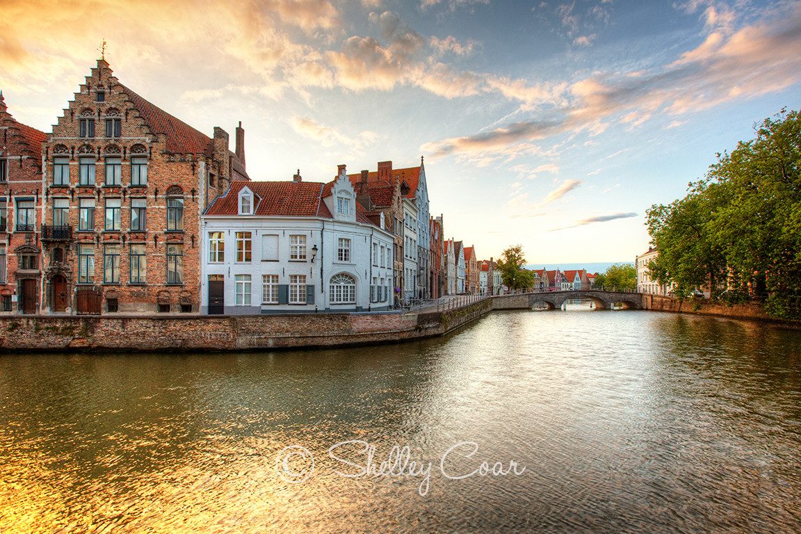 Sunset photograph of the iconic canals and waterways in Bruges, Belgium by Shelley Coar.