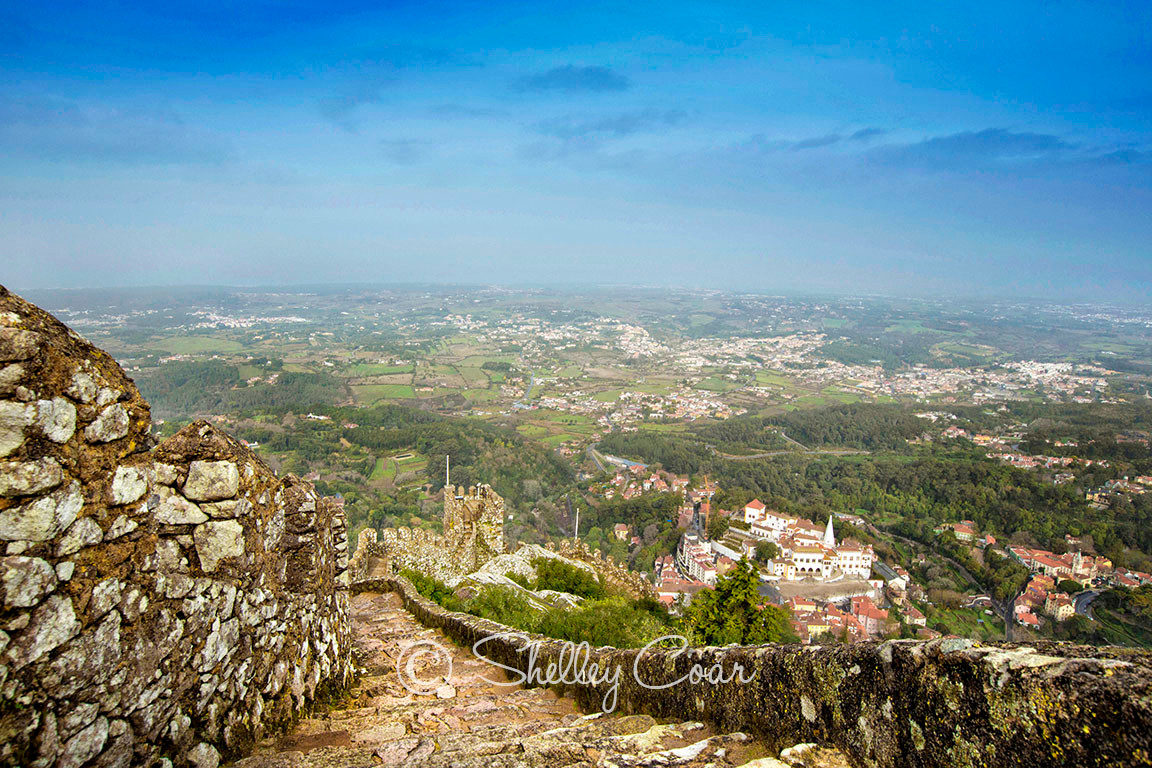 A photograph down the stone pathway of the The Castelo dos Mouros (The Moors Castle) in Sintra, Portugal by Shelley Coar.