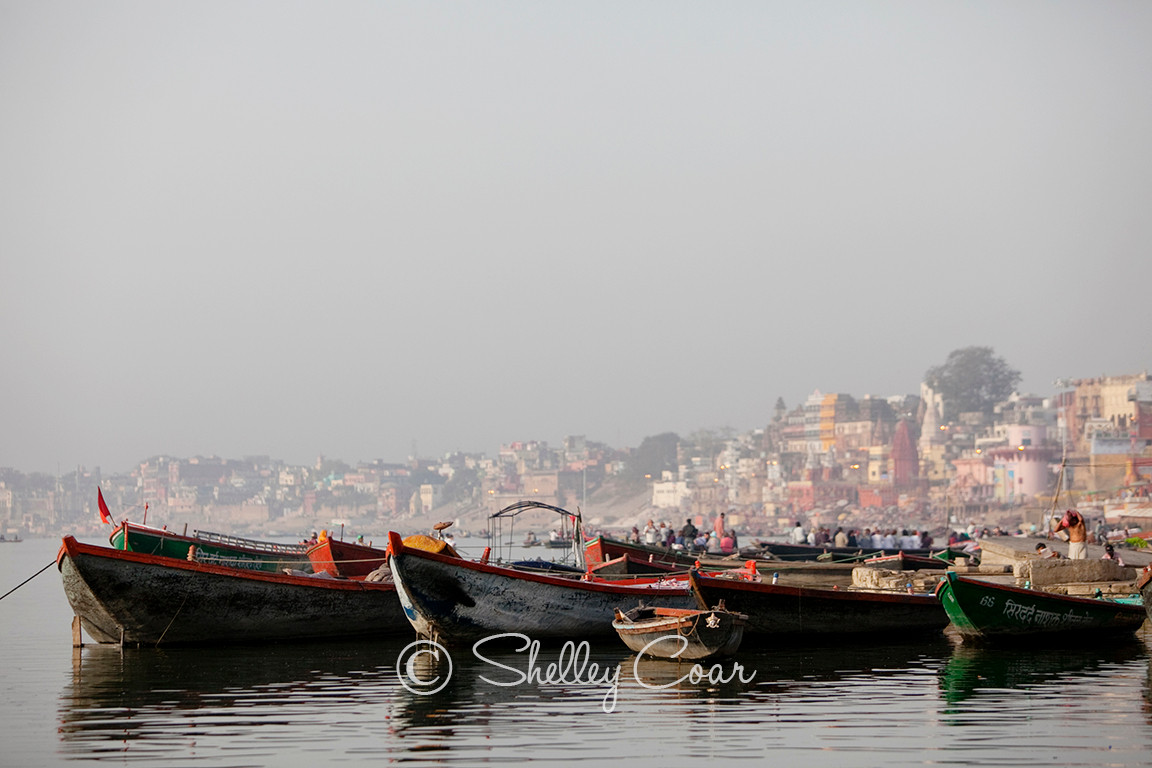 A photograph at dawn on the sacred River Ganges in Varanasi, India by Shelley Coar.