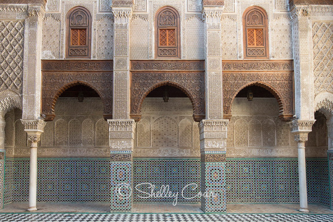 A photograph of a white and blue tiled Moroccan riad or garden courtyard in Fez, Morocco  by Shelley Coar.