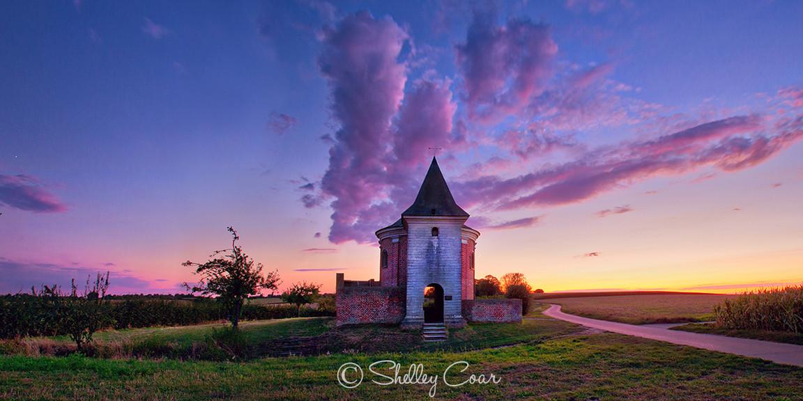 An August sunset over a little country-side Belgian chapel near Hoksem.