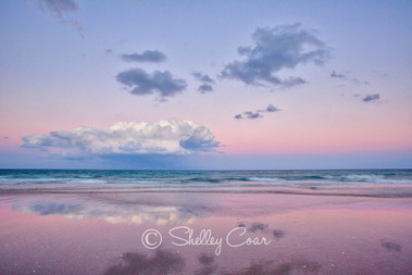 A beach sunset overlooking the Atlantic Ocean at Boca Raton, Florida. Landscape photograph by Shelley Coar.
