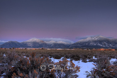 Sangre de Cristo Winter Solstice by Shelley Coar. Photograph of sunset over Taos valley, New Mexico for sale as print or canvas.