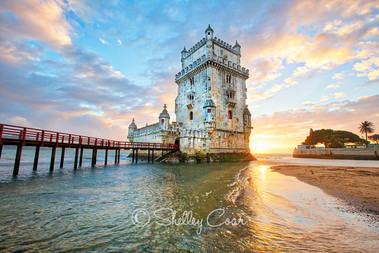 A photograph at sunset of the tower of Belem in Lisbon, Portugal by Shelley Coar.