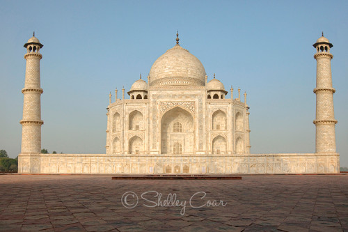 A photograph of the Taj Mahal at sunrise in Agra, India  by Shelley Coar.
