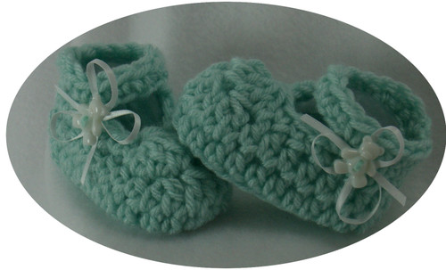 Hand crocheted Mary Jane Style baby booties for every precise little girl.