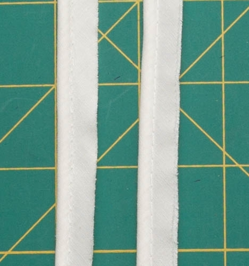 Piping off white per metre