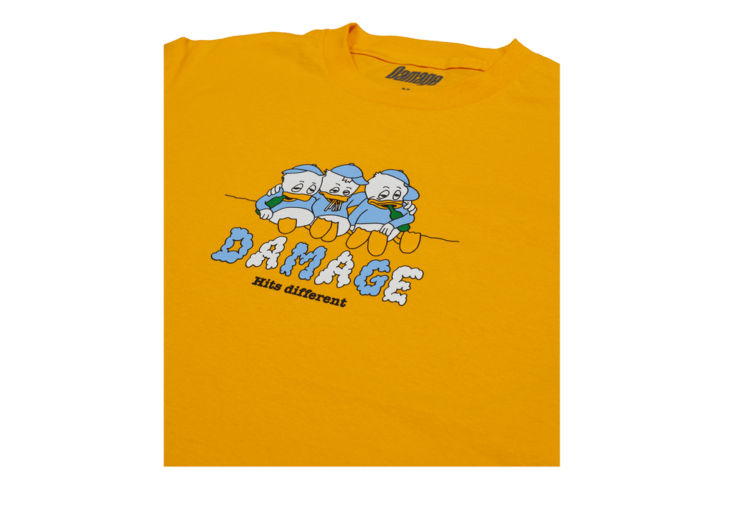 Damage - Hits Different Tee Gold