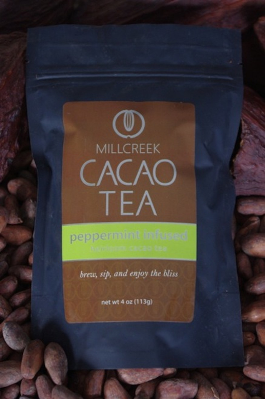 """Refreshing and crisp, this infusion of peppermint flavors is playful on the palette.  Invigorate the senses with all natural peppermint flavors combined with a unique blend of roasted cacao nibs and theobromine-rich shell. The chocolate undertones play jubilantly with the peppermint sensations to create a delicious pairing in this Heirloom Cacao Tea. Made from the same 100% single source Ecuadorian cacao beans used in our artisan chocolate, this tea has a delicate cacao flavor with beautiful aromas.  Using our knowledge as farm to bar chocolate makers, we have crafted a delicate cacao tea using our rare, heirloom Arriba Nacional beans. Imported directly from our farmer in the Los Rios region of Ecuador, this exotic and rare bean is roasted to release the beautiful flavors within. This Heirloom Cacao Tea uses both roasted nibs and theobromine-rich shells to create a delicate tea with lovely chocolate nuances.  Cacao Benefits:  Rich in antioxidants, amino acids, and magnesium Cacao contains Theobromine, said to give a euphoric feeling Cacao contains Anandamide, an endorphin, whose name appropriately translates as """"bliss"""" Brew, sip and enjoy the bliss"""