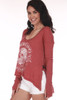 side shows sublime logo printed in white on red thermal with long sleeves and v neckline