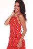 front shows red and white polka dot patterned knee length mini dress with spaghetti straps. Fully Lined.