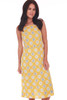 front shows yellow  and white circle patterned knee length mini dress with spaghetti straps. Fully Lined.