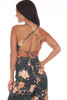Back shows dark emerald green jumpsuit all over floral print with adjustable criss-cross  spaghetti straps, middle back tie, hidden zipper at middle back.